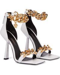 Versace Sandales en cuir à ornements - Blanc