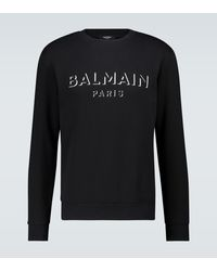 Balmain Sweat-shirt en coton à logo - Noir