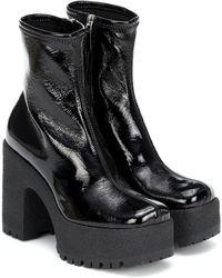 Miu Miu Botines de piel sintética con plataforma - Negro