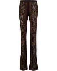 Versace Pantaloni flared a stampa Python - Multicolore