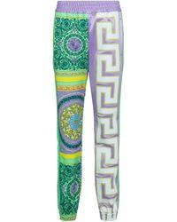 Versace Pantalones de chándal de punto estampado - Verde