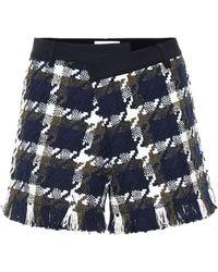 Monse Checked asymmetric waist shorts - Blau