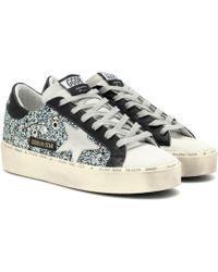 c8850f4b1c63 Golden Goose Deluxe Brand Navy Suede Glitter Mid Star Sneakers in ...