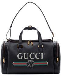 Gucci - Print Leather Travel Bag - Lyst
