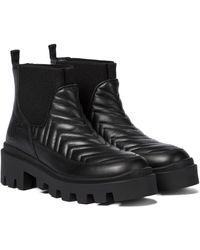 Gucci Ankle Boots aus Leder - Schwarz