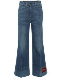Gucci Jean flare à taille haute et appliqué - Bleu