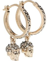 Alexander McQueen Boucles d'oreilles Skull ornées de cristaux - Métallisé