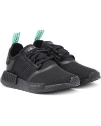 e15111c55fefd Lyst - Adidas NMD R1 - Women s Adidas NMD R1 Sneakers