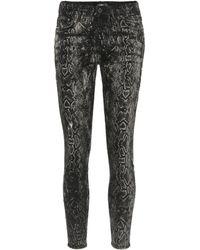 Amiri Skinny-Jeans mit Schlangenleder-Print - Schwarz