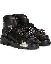 Versace Ankle Boots aus Leder - Schwarz