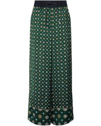 Sacai Bedruckte Hose aus Satin - Grün