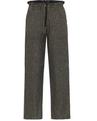 Saint Laurent Pantalones metalizados de rayas - Negro