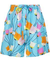 Gucci Bedruckte Shorts aus Seide - Blau