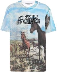 Stella McCartney Camiseta No Smile No Service con estampado - Blanco