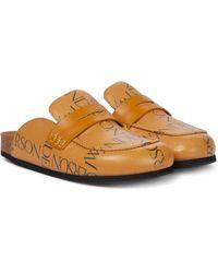 JW Anderson Slippers de piel con logo - Marrón