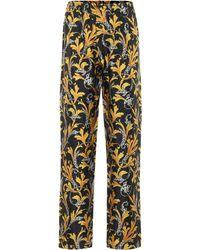 Versace Pantalon imprimé à taille haute en soie - Multicolore
