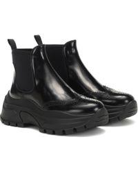 Prada Ankle Boots aus Leder - Schwarz