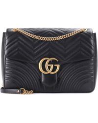 Gucci Sac à épaule taille moyenne à motif GG Marmont matelassé - Noir