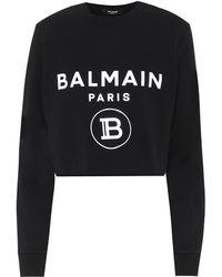 Balmain Sweat-shirt raccourci imprimé en coton mélangé - Noir