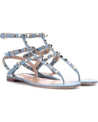 d2ac29e04310 Lyst - Valentino Strappy Rockstud Sandals in Brown