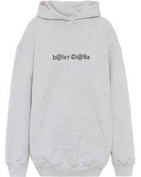 Balenciaga Sweat-shirt en coton à capuche et logo - Gris