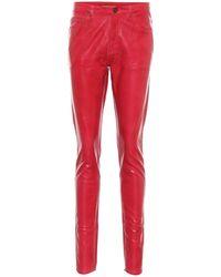Saint Laurent Beschichtete Mid-Rise Slim Jeans - Rot