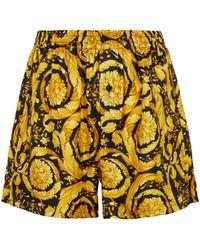 Versace Shorts de pijama de seda estampados - Negro