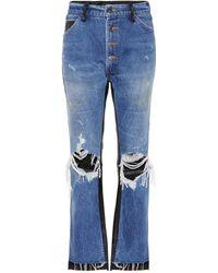 Amiri Jeans cropped con detalles de piel - Azul