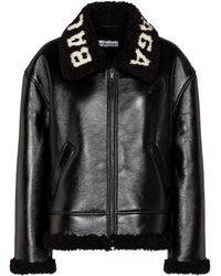 Balenciaga Veste en cuir et shearling à logo - Noir