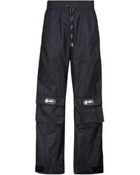 Off-White c/o Virgil Abloh Pantalones rectos cargo de nylon - Negro