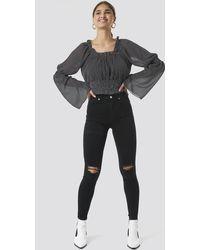 NA-KD Skinny High Waist Destroyed Jeans - Schwarz