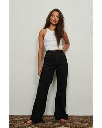 NA-KD Trend Jeans Met Relaxed Bootcut Pasvorm - Zwart