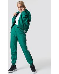NA-KD Side Stripe Tracksuit Pants - Groen