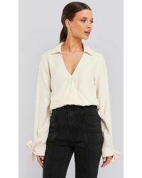 NA-KD - Trend Tie Cuff Wrap Blouse - Lyst