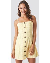 NA-KD Céline & Talisa x Button Down Mini Dress - Gelb