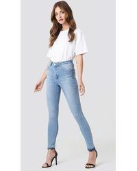 NA-KD Skinny High Waist Open Hem Jeans - Blauw