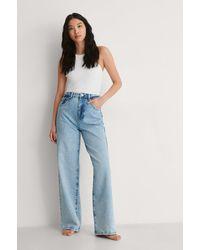 NA-KD Trend Jeans Mit Hoher Taille Und Weitem Bein Im Vintage-Look - Blau