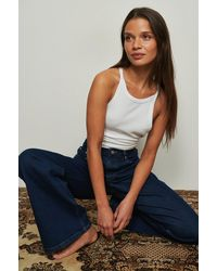 NA-KD Trend Jeans Met Relaxed Bootcut Pasvorm - Blauw