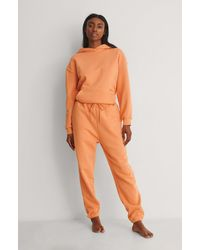 NA-KD Trend Spitz zulaufende Bio-Sporthose - Orange