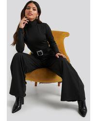NA-KD Turtle Neck Long Sleeve Jersey Jumpsuit - Zwart