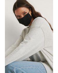 NA-KD 2-pack Solid Flat Masks - Zwart