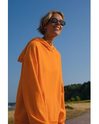 NA-KD Trend Sweatshirt À Capuche Bio Surdimensionné Avec Poche - Orange