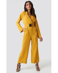 NA-KD Hoss x Belted Wrap Front Jumpsuit - Gelb