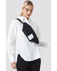 Calvin Klein - Item Story Waist Bag Black - Lyst