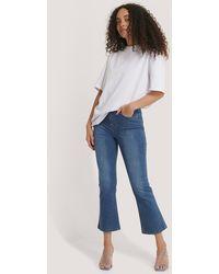NA-KD Blue Kick Flare Skinny Jeans