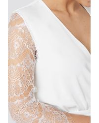 NA-KD Luisa Lion x Lace Playsuit - Weiß