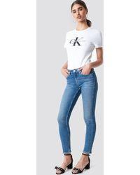 Calvin Klein - Mid Rise Skinny West - Lyst