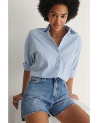 NA-KD Organisch Jeanshort Met Ruwe Zoom - Blauw