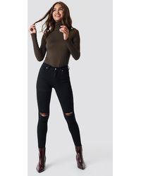 NA-KD Skinny Mid Waist Destroyed Jeans - Zwart
