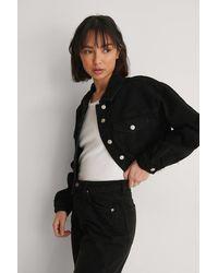 NA-KD Black Organic Cropped Raw Hem Denim Jacket